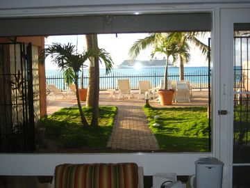 View of back yard which overlooks beach and ocean