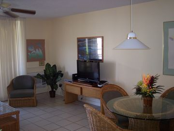 living room/dining area and entertainment center
