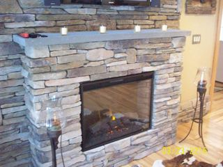 Thornton house photo - large stone electric fireplace