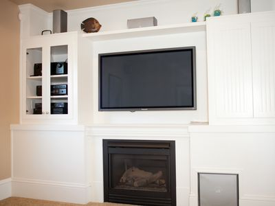 "Media room on main floor. Sound system, 52"" plasma, fireplace, fold-out couch."