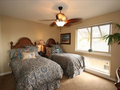Upstairs guest bedroom with twin beds, flat-screen tv, attached full bathroom