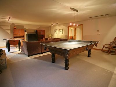 lower flr game room with sunroom (pool table/table tennis/fooseball/game system)