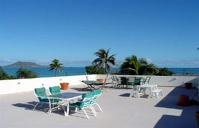 Soak up the sun and feel the ocean breeze on the rooftop lanai over beach