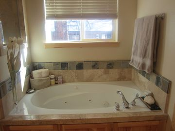 Bathroom in the Master Suite. Tub is a jetted jacuzzi tub.
