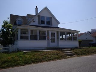 Falmouth house photo - Nice large front porch with great views of the beach.
