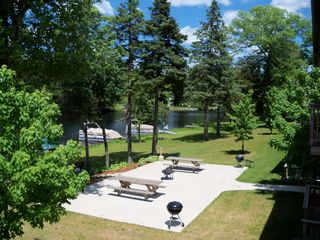 Crivitz condo photo - The riverfront picnic area offers charcoal grills, firepits & waterfront seating