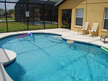 Sandy Ridge house rental - A covered lanai overlooks the enclosed heated pool.