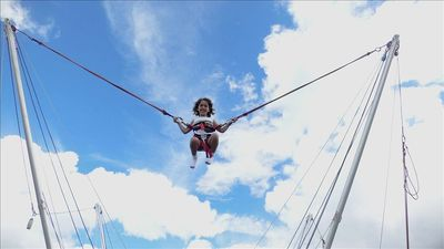 My niece bungee jumping at the recreation park