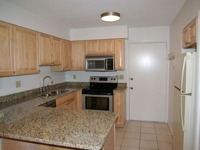 Pristine New Kitchen with Spacious Granite Counters and Extra Cabinets