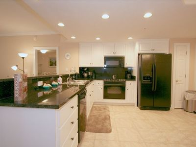 Lower Grand Lagoon condo rental - The kitchen is decorated with granite counter tops