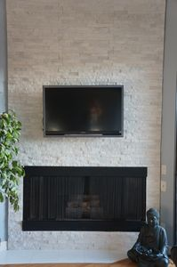 New fireplace with mounted flat panel Sony TV