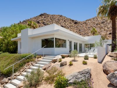 Mid-century hillside home - level in and out. Casita and garage right of wall.