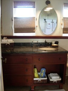 Custom West Indian vanity, antique French mirror