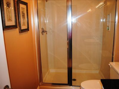 Easy access shower Granite counter tops Across Hall from Bunk Beds