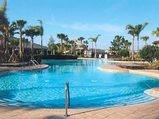 Windsor Hills condo photo - Heated lagoon pool w/ zero entry area & 2-story slide.