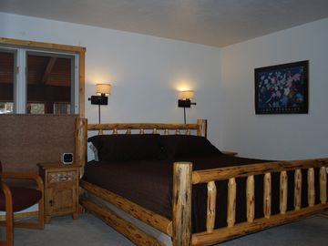 Master bedroom with king size bed - view 1