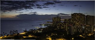 Honolulu condo photo - The Waikiki city lights come alive as evening arrives to Trump Waikiki 2503