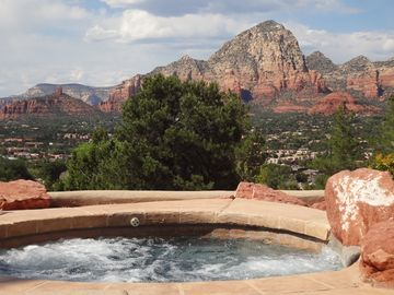 Soak in the 10 person jetted spa and almost touch the mountains.