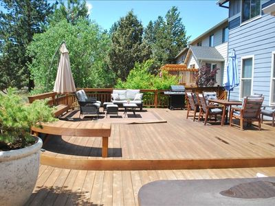 Large deck with hot-tub, sofa seating area, dining area. Gas BBQ for Grilling.