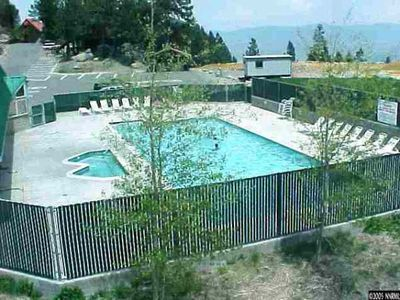 Outdoor swimming pool and spa just steps from the condo!