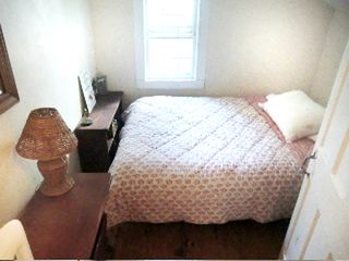 Great Barrington house photo - pink and white room, double bed