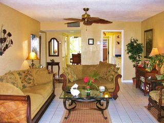 St. Croix condo photo - Lovely comfy, living area with warm Caribbean decor and breezes