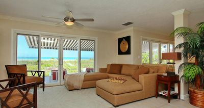 Designer Furnished Living Room With Beach View
