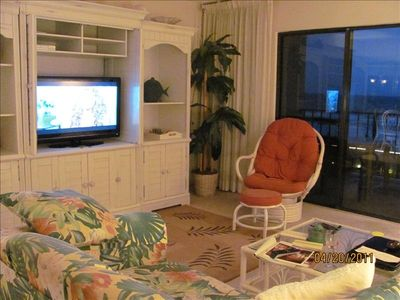 Comfortable living room with a million dollar view and a large HDTV and DVD.
