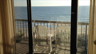 Beautiful ocean view from living room; balcony has 4 reclining chairs (2 shown).