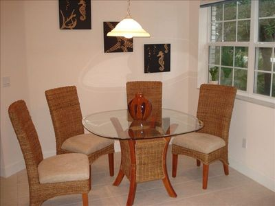 Dining area with designer wicker dining set
