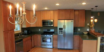 Kitchen with new stainless fridge, gas stove, microwave, coffeemaker, dishwasher