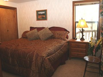 Master bedroom downstairs with King size bed with Tempurpedic mattress