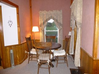 Jefferson farmhouse photo - Cozy breakfast nook in den/living room with view of pond and garden.