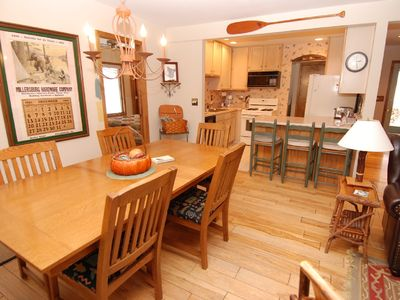 Dining room and breakfast bar with well equipped kitchen
