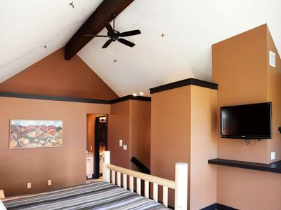 Master Bedroom with ceiling fan, flat screen tv
