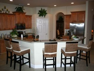 Estero house photo - Kitchen w granite,stainless & walk-in pantry.