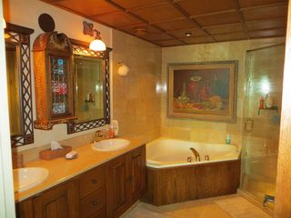 Nuevo Vallarta condo photo - En suite bath attached to first-floor master. Jacuzzi tub, walk-in marble shower