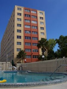 Outdoor pool and the condo building
