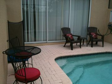Enjoy your morning coffee or refreshing beverage sitting by your private pool.