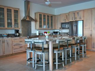 Providenciales - Provo villa photo - A cooks modern kitchen with induction stove, huge island with room for all.