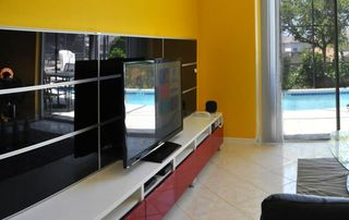 Emerald Island house photo - 55inch HDTV with Nintendo Wii and DVD