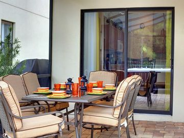 Perfect shaded retreat with a designer fan to cool you down whilst barbecuing!