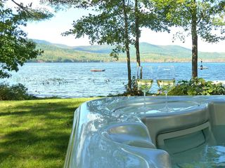 Fryeburg cottage photo - Relax in the hot tub while enjoying the beautiful lake and mountain views.