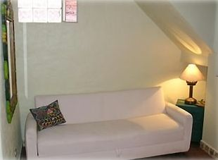 Small first floor study with sofa that pulls out to a single bed