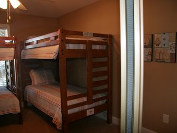 The 2nd upstairs bunkbed room also with flat screen tv!