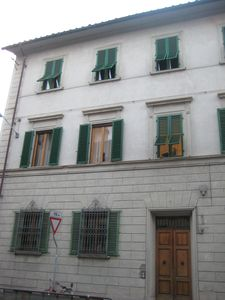 The building from outside: the three windows on top are part of the aparrment