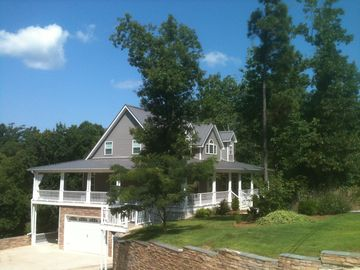 Pickwick Lake house rental - Hillside property with convenient access to water and lots of off-road parking