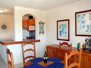 Puerto Aventuras condo photo - Dining area - the bottle of wine is on us, cheers!