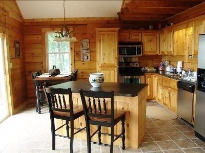 Spacious Kitchen With Stainless Appliances / Dining Area With Island