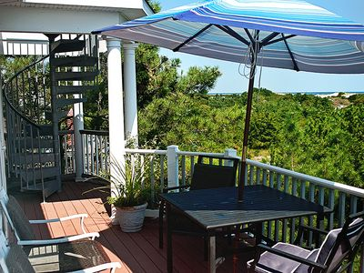 Deck off of main living area. 180Degree view of the ocean. Steps to rooftop deck